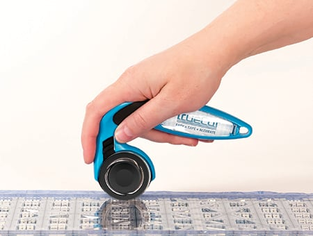 holding rotary cutter with finger